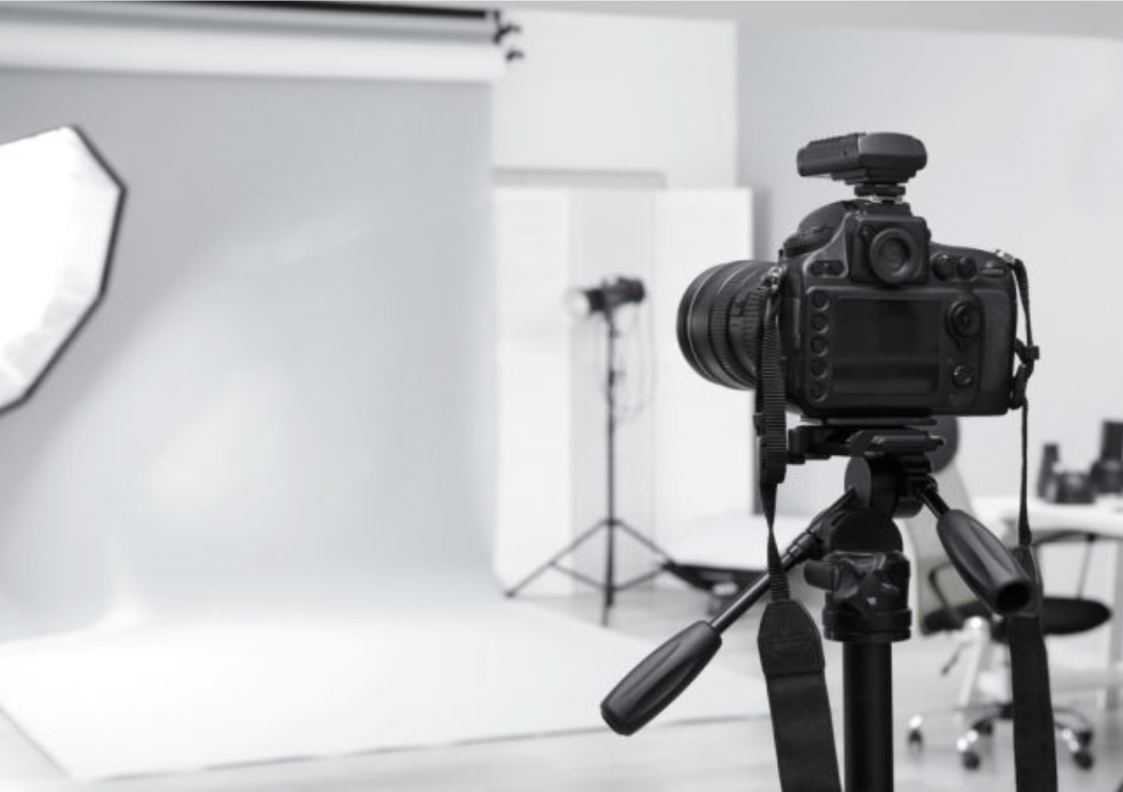 An image of a camera in a photoshoot set up. Using our in-house design team we create branded imagery that will set you apart from your competition.